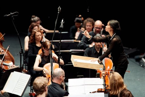 Strings On Stage With Conductor Tiyani