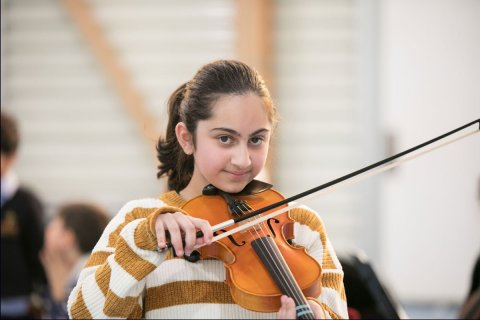 Female Student Playing String Instrument 1200X800